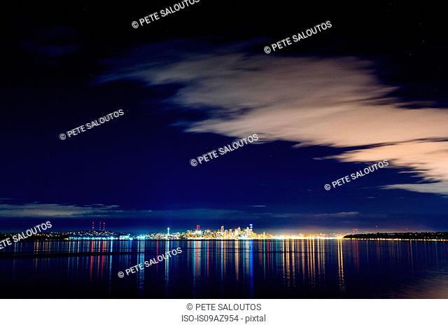 Distant skyline and city lights at night, Seattle, Washington, USA