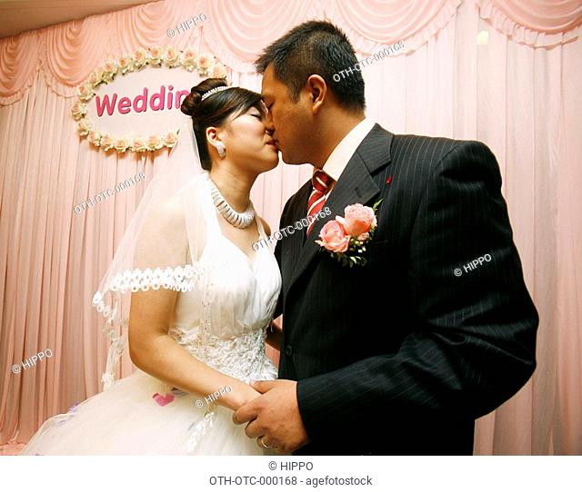 A newly wed couples at the wedding reception, Shanghai, China