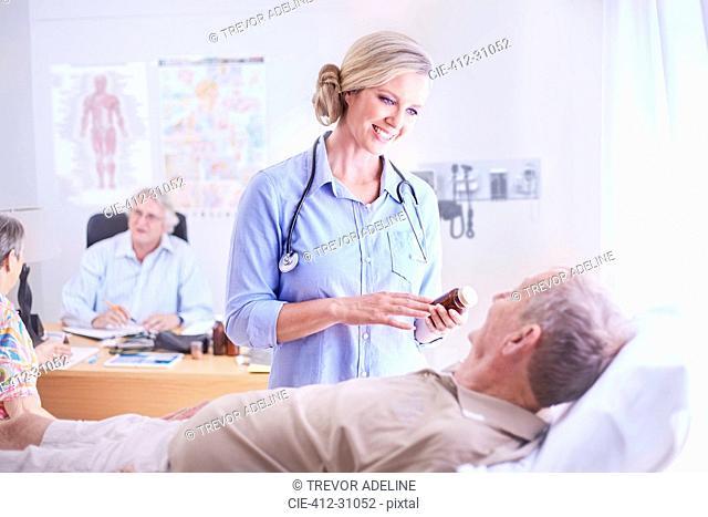 Doctor discussing prescription medication to senior man