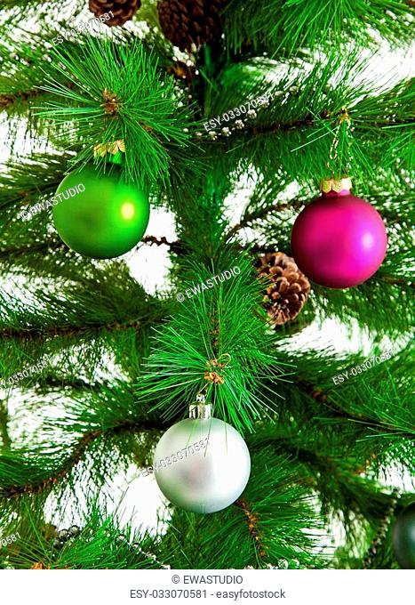 christmas decorations. Christmas ball and green spruce branch