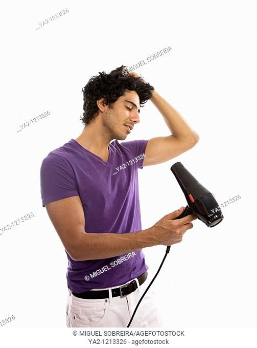 Man blowdrying his hair