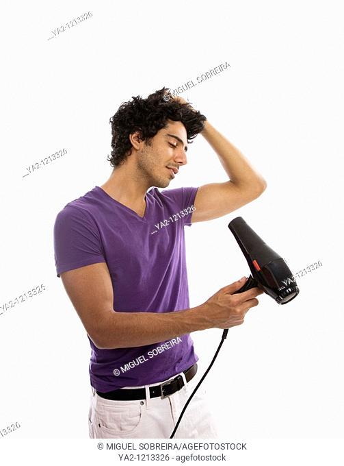 Man blowdrying his hair