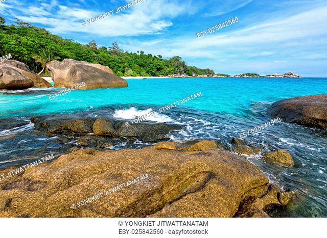 Beautiful landscape of blue sky sea and white waves on beach near the rocks during summer at Koh Miang island in Mu Ko Similan National Park, Phang Nga province