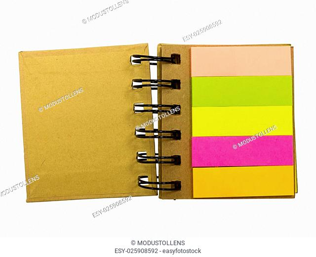 Blank note stickers stuck to spiral notebook isolated on white