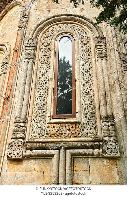 Close up picture & image of the geometric architectural stone wrok af the apse window of the medieval Khobi Georgian Orthodox Cathedral, 10th -13th century