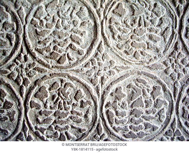 Stone carving floral motive at Angkor Wat temple, Cambodia