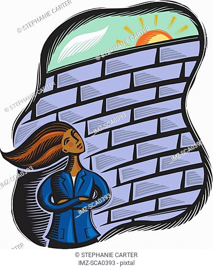 Businesswoman faced with a brick wall