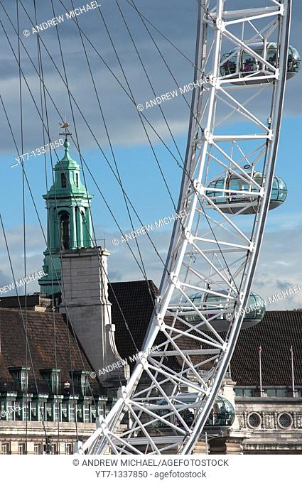 The 'London eye' Millennium wheel in the foreground with the London Aquarium County Hall or old GLC Building at the rear