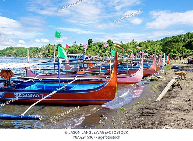 Traditional Bangka boats docked on on the shore of Taal Lake on Taal Volcano Island, Talisay, Batangas Province, Philippines