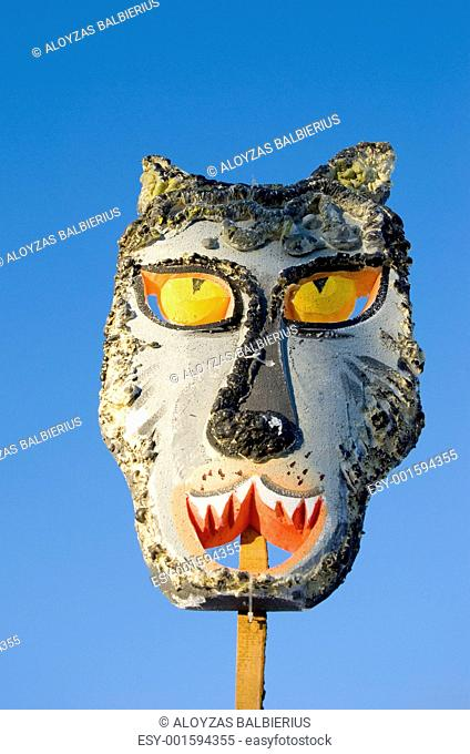 Mardi Gras wolf mask on sky background