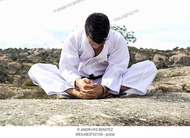 Man stretching before a martial arts training