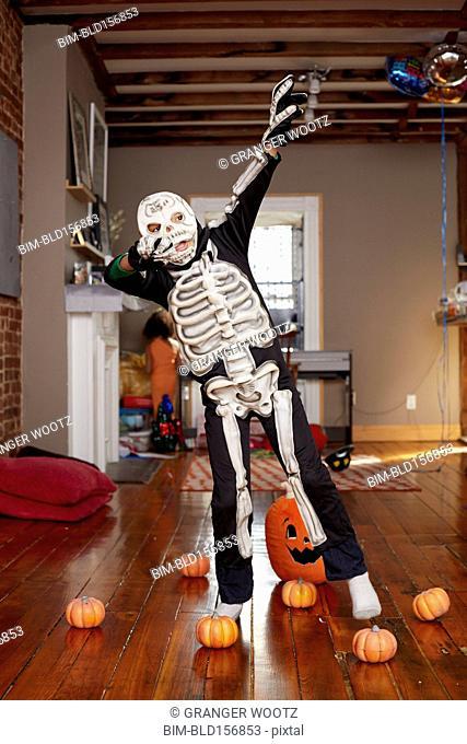 Black boy wearing skeleton Halloween costume