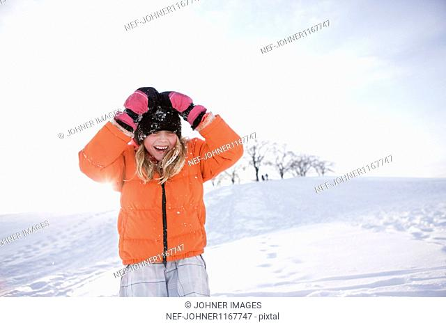 Girl playing on snow