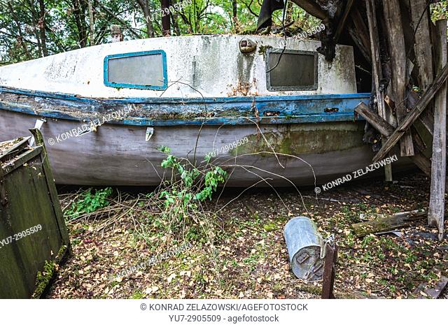 Old boat in yacht club in Pripyat ghost city of Chernobyl Nuclear Power Plant Zone of Alienation in Ukraine