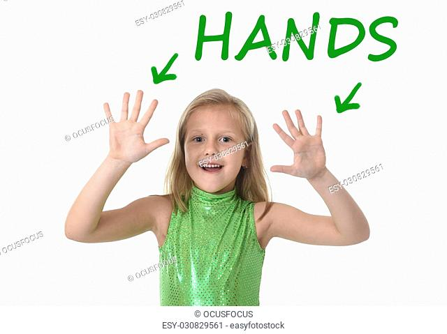 6 or 7 years old little girl with blond hair and blue eyes smiling happy posing isolated on white background showing hands in learning English language school...