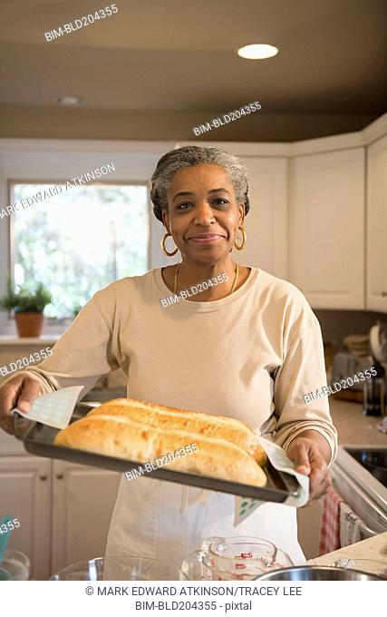 African American woman baking in kitchen