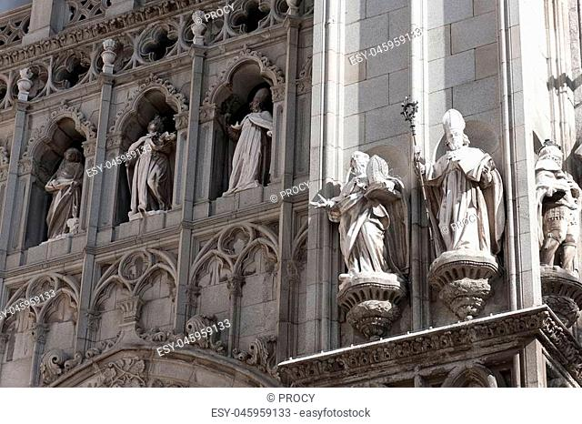 statues in the facade of saint mary cathedral in toledo, spain