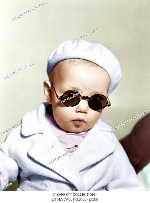 Portrait of baby wearing beret and sunglasses Old Visuals