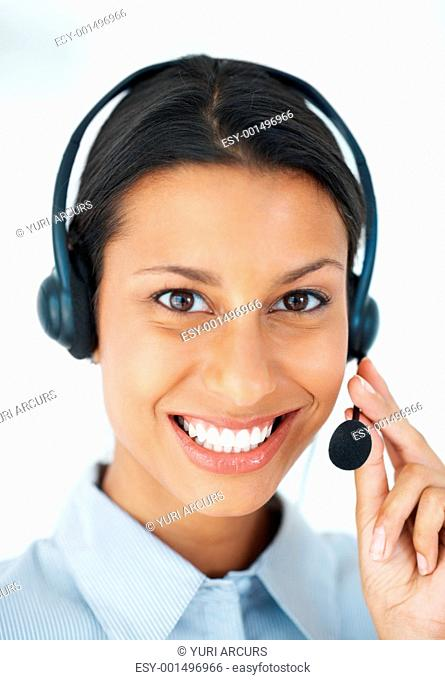 Portrait of beautiful call center employee smiling over white background