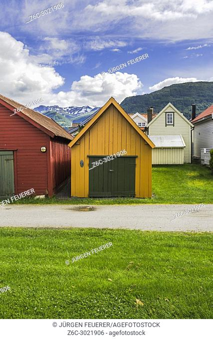 colourful boathouses and mountain view, Norway, wooden huts in Vik i Sogn, Sognefjorden