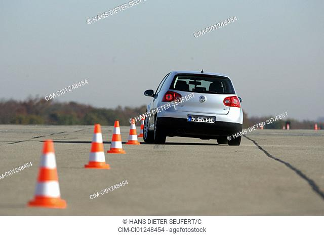 VW Volkswagen Golf GT, Golf V, model year 2005-, silver, driving, diagonal from the back, rear view, test track, Pilonen