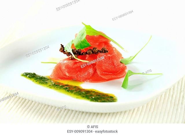 Thin slices of raw beef with pesto