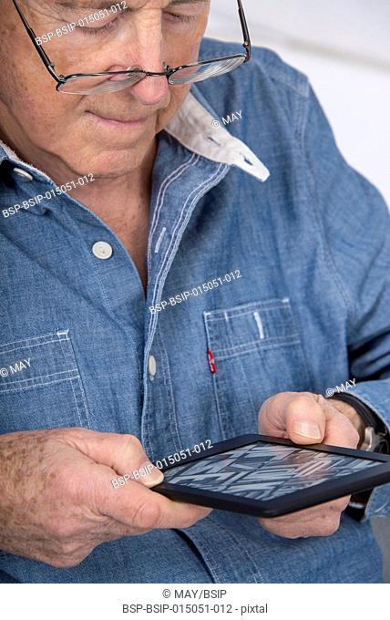 Senior man reading an ebook