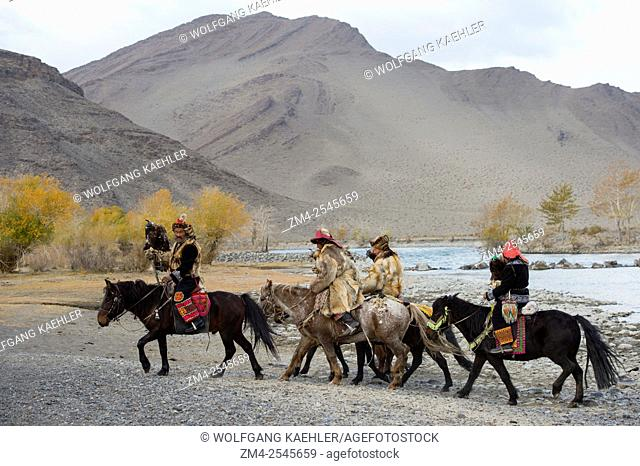 A group of Kazakh Eagle hunters and their Golden eagles on horseback at the Hovd River near the city of Ulgii (Ölgii) in the Bayan-Ulgii Province in western...