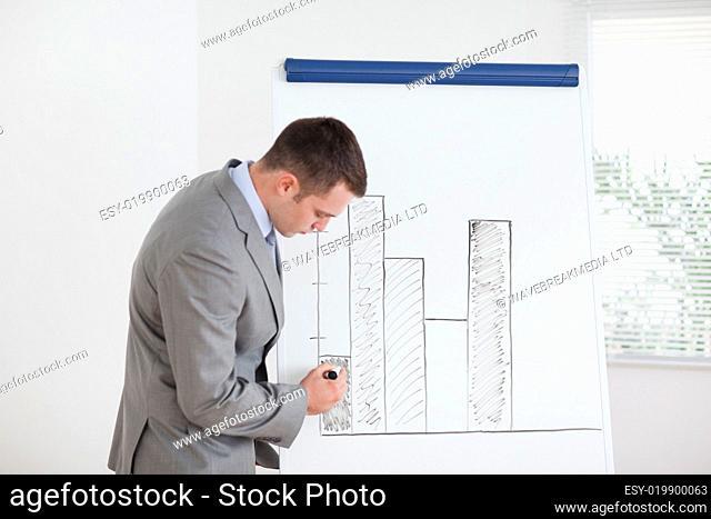 Businessman editing column graph