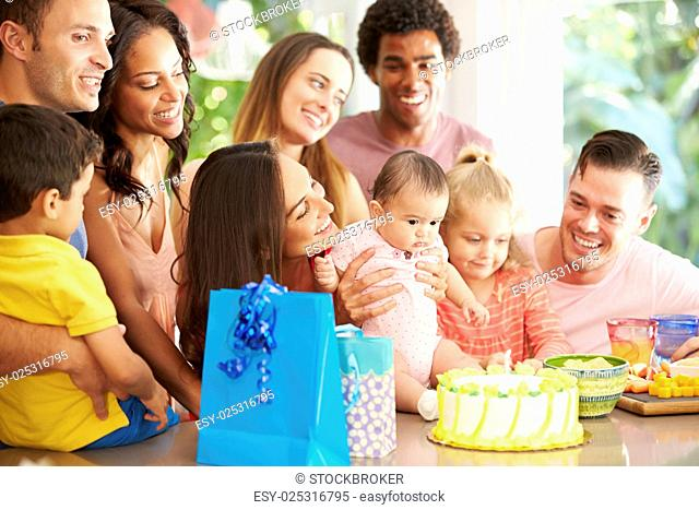 Group Of Families Celebrating Child's First Birthday At Home