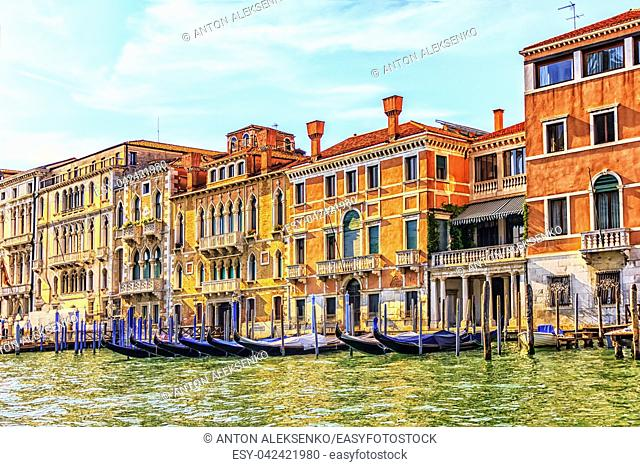 Palaces on the shore of Grand Canal and gondolas rent in Venice