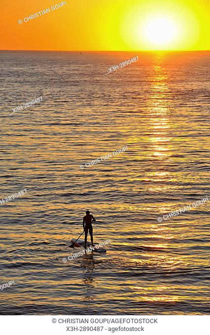 stand up paddle at sunset, Etretat, Seine-Maritime department, Normandie region, France, Europe