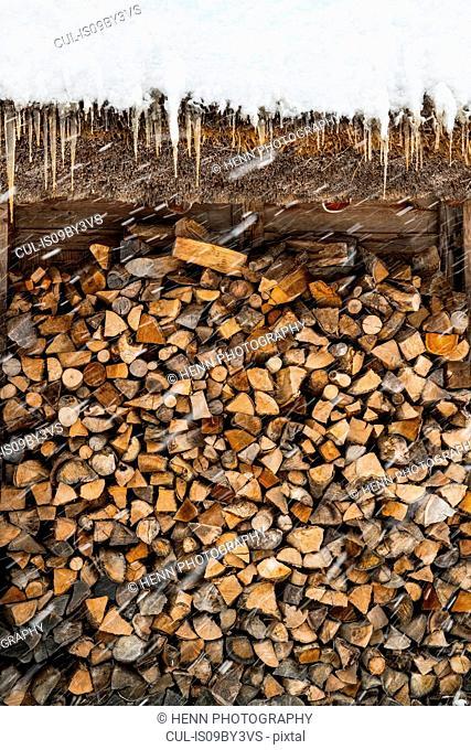 Stacked firewood in winter snow, detail, Shirakawa village, Takayama, Gifu, Japan