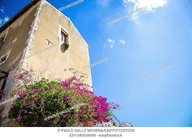 Traditional old Sicilian house during a sunny day with a wonderful blue sky background