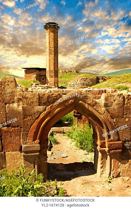 Medieval Gothic Door Arch infront of The Seljuk Turk Mosque of Ebul Minuchihr Minuchir built in 1072, Ani archaelogical site on the ancient Silk Road , Kars