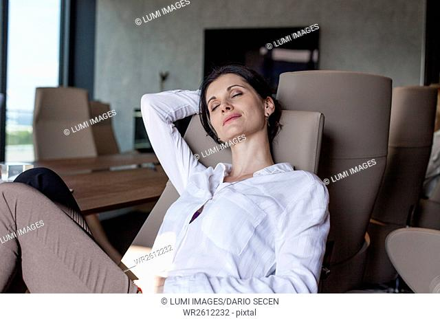 Businesswoman in office taking a nap
