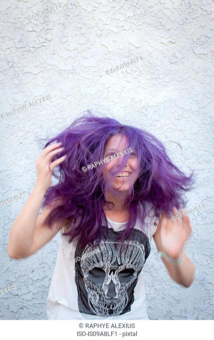 Young woman wearing purple wig