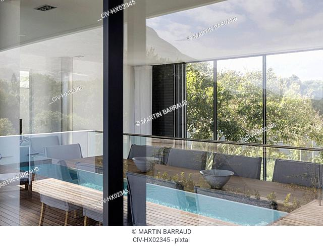 Home showcase interior dining room surrounded by windows