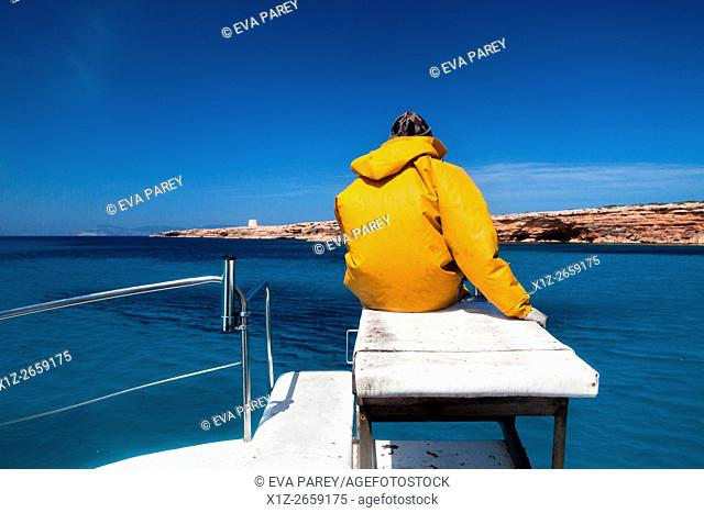 A fisherman fishing in front of Punta Sa Gavina. Formentera (Balearic Islands)