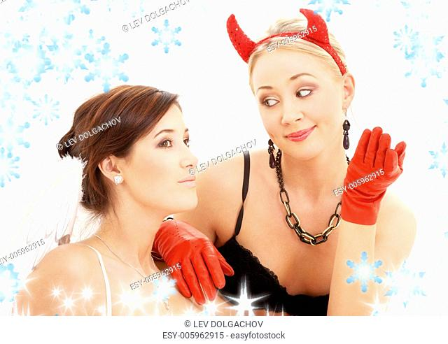 picture of angel and devil girls with snowflakes