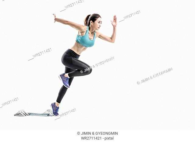 Side view of female athlete running
