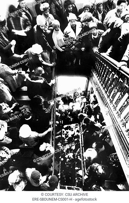 Unemployed standing in line for perspective public service jobs, City Hall, Chicago, IL, 01-21-75