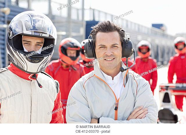 Racer and manager standing on track