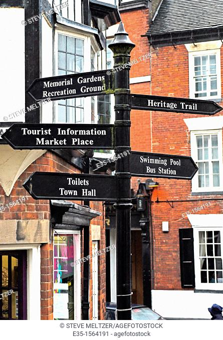 A signpost in the center of the British town of Matlock directs tourists to various sights
