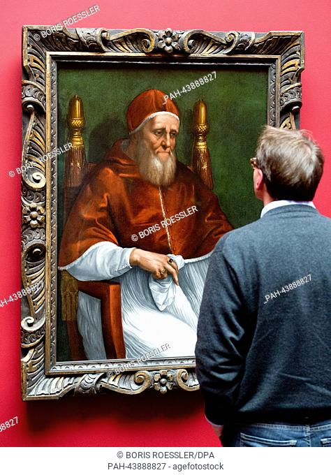 Visitors look at a portrait of Pope Julius II at the Staedel museum in Frankfurt Main, Germany, 07 November 2013. The Staedel Museum acquired the hitherto...