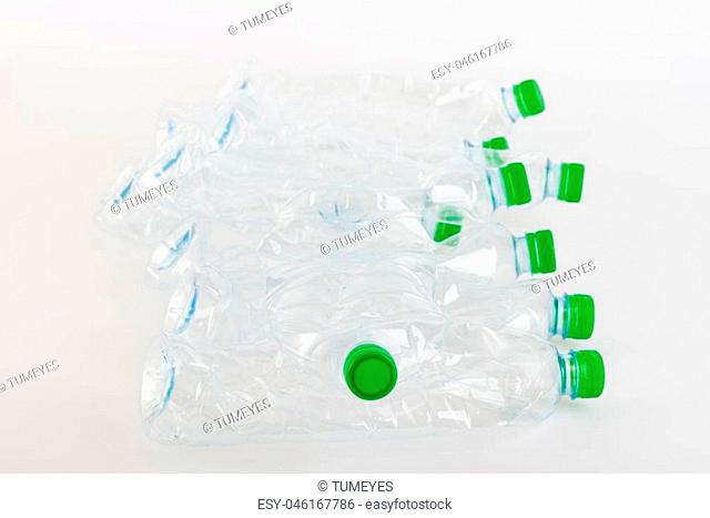 Recyclable garbage of plastic bottles on white background