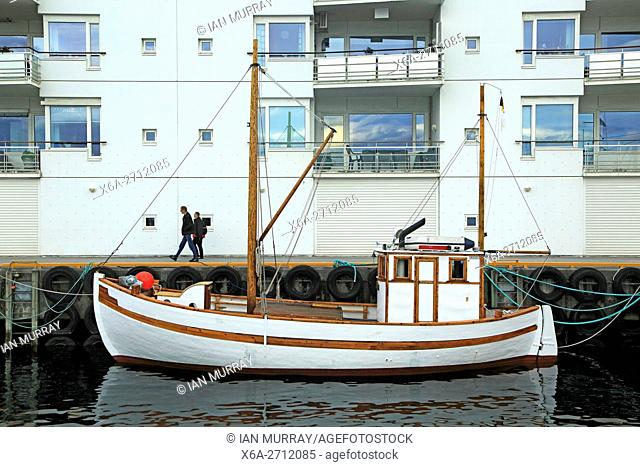Traditional wooden boat outside modern housing apartments, Molde, Romsdal county, Norway