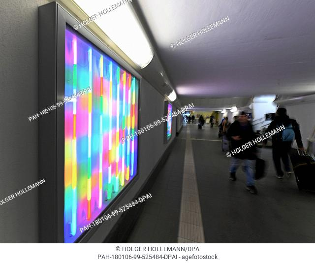 Light boxes of the artist Albert Hien shine bright in the underpass at the main station in Celle, Germany, 19 December 2017