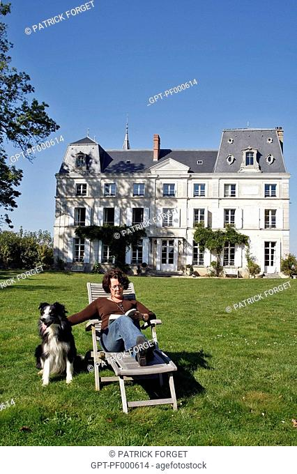 READING IN A DECKCHAIR IN FRONT OF THE CHATEAU DE LA PUISAYE, VERNEUIL-SUR-AVRE