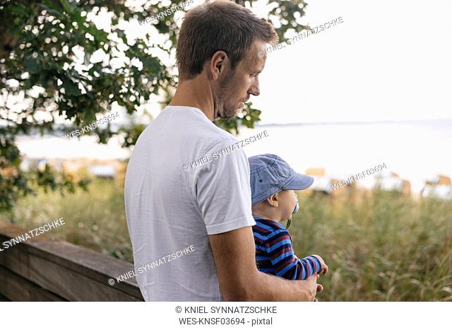 Germany, Timmendorfer Strand, father holding his son